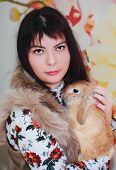 stock photo of dwarf rabbit  - portrait of a girl with a little dwarf rabbits - JPG