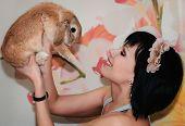 foto of dwarf rabbit  - portrait of a girl with a little dwarf rabbits  - JPG