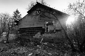 stock photo of abandoned house  - Old abandoned house in sunlight - JPG