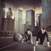 image of disadvantage  - Men locked in a challenge from handicap - JPG