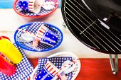 image of barbie  - Table set with white blue and red decorations for July 4th barbecue - JPG