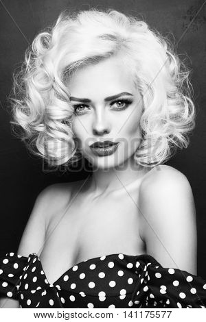Black and white vintage style portrait of young beautiful sexy blonde pin up girl with