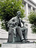 Side Angle Of Statue Of Abe Lincoln Sitting Down In Front Of City Hall In San Francisco