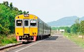 foto of railcar  - Express diesel railcar passing the station of dam in central of Thailand - JPG