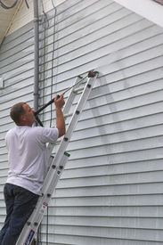 image of pressure-wash  - Contractor pressure washing house removing mildew  - JPG