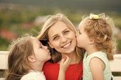 Kids Enyoj Happy Day. Woman And Girls Sit On Bench. Daughters Kiss Mother On Natural Landscape. Moth poster