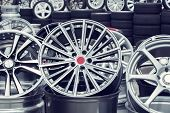 Wheel Rims On Showcase. Car Alloy Wheels At A Wheel Shop poster