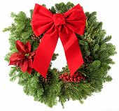 stock photo of christmas wreath  - Christmas wreath made from real pine boughs isolated on white background - JPG