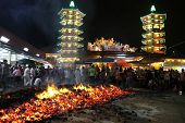 AMPANG, MALAYSIA â?? OCT 05: Devotees collect the charcoal believed to be blessed after the fire-wal