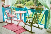 Pink And Green Wooden Rocking Chairs And Table On Porch Or Balcony. Two Relaxing Armchairs On Porch  poster