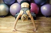 Sensual Woman Body. Girl Athlete Do Handstand With Legs On Stepper In Gym With Colorful Fit Balls. E poster