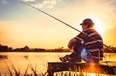 Fisherman Caught Fish. Caucasian Man Catch Fish On Lake. Angler On River Fishing. Fishing Rod Lake F poster
