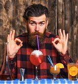 Man Shows Ok Gesture On Wooden Background. Alcohol And Cocktails Concept. Hipster Enjoy Drink Or Coc poster