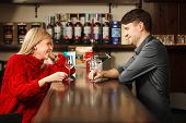 Bartender In Work Uniform And Girl In Knitted Sweater Taste White Rum At Bar Counter, Smile And Have poster