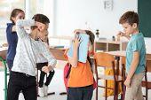 Children bullying their classmate in school poster