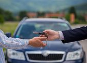 Selling A Car, The Seller Gives The Car Keys To The Buyer, Buying A Car, Buying A New Car With A Smi poster