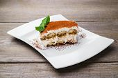 Tiramisu Cake, Traditional Dessert On Porcelain Plate. Italian Cuisine, Pastry, Confectionery, Resta poster