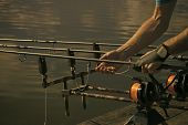 Rods, Reels, Lines And Male Hands On Water Background, Fishing. Fishing Equipment, Gear, Device. Ang poster