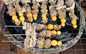 stock photo of giblets  - Grilled giblets over gridiron and natural charcoal - JPG