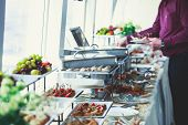 Beautifully Decorated Catering Banquet Table With Variety Of Different Food Snacks And Appetizers On poster