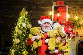 Christmas Holidays. Happy New Year. Santa Man With Toy Teddy. Happy Santa Claus With Teddy Bear. Bea poster
