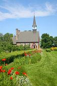 stock photo of acadian  - The Memorial Church of Grand Pre located in the Annapolis Valley of Nova Scotia in the Grand Pre National Historic Site - JPG