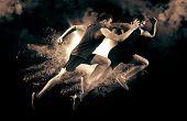 Athletic men sprinter running on smoke background. Exploding start poster