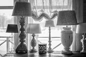 Old Table Lamp Standing On The Table, Carved Legs, Lots Of Lamps, A Vintage Lamp Bw poster