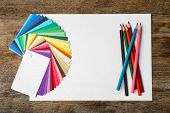 Color Palette, Pencils And Blank Paper Sheet On Wooden Background, Flat Lay. Space For Text poster