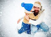 Happy Family Son Hugs His Dad On Winter Holiday. Merry Christmas And Happy New Year. Daddy And Boy S poster