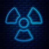 Glowing Neon Line Radioactive Icon Isolated On Brick Wall Background. Radioactive Toxic Symbol. Radi poster