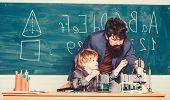 Teacher And Child School Classroom. Chemistry Lesson. Lab Experiment. School Education Concept. Prim poster