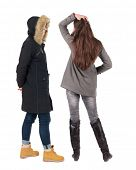 Back view of two young girl in winter jacket. Rear view people collection. backside view of person.  poster