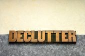declutter word in vintage letterpress wood type against handmade textured amate paper, simplicity, m poster
