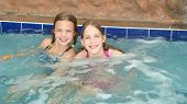 stock photo of hot-tub  - Youth girls soaking in the hot tub - JPG