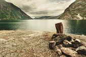 Bonfire And Fjord Landscape Near Erdal Village In Norway, Scandinavia Europe. Tourism Vacation And T poster