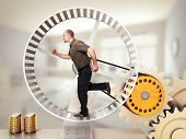 stock photo of hamster  - man run on hamster wheel - JPG