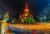 Unidentified Buddhists Making Candle Light Procession Around The Pagoda  In Wat Yai Chamongkon, The  poster