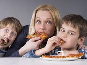 stock photo of strawberry blonde  - Hungry family - JPG