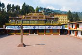 stock photo of karma  - The empty courtyard of the Rumtek monastery a tourist attraction and home of the Karmapa and Karma Kagyu order of Buddhism located in Gangtok Sikkim India - JPG