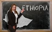 Teacher Showing Map Of Ethiopia On Blackboard