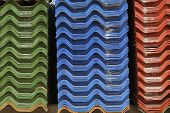 picture of asbestos  - Stack of colorful asbestos roof in warehouse - JPG