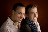 image of gay couple  - Portrait of two young men embracing in studio - JPG