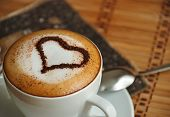 foto of dessert plate  - cup of cappuccino decorated with a heart of cocoa - JPG