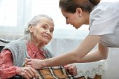 stock photo of gratitude  - Female nurse is taking care of the senior woman - JPG