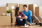 stock photo of flirt  - Young couple moving in their new house - JPG