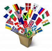 pic of flags world  - Global shipping and freight services and worldwide delivery transport with an open cardboard cargo box and flags from around the world flying out on a white background - JPG