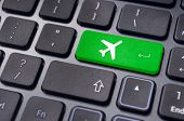 picture of keypad  - a plane sign on keyboard to illustrate online booking or purchase of plane ticket or business travel concepts - JPG