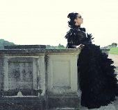 image of evil queen  - Dark Queen in park - JPG