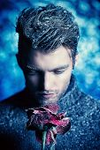 stock photo of rose  - Portrait of a handsome man dressed in winter clothes - JPG